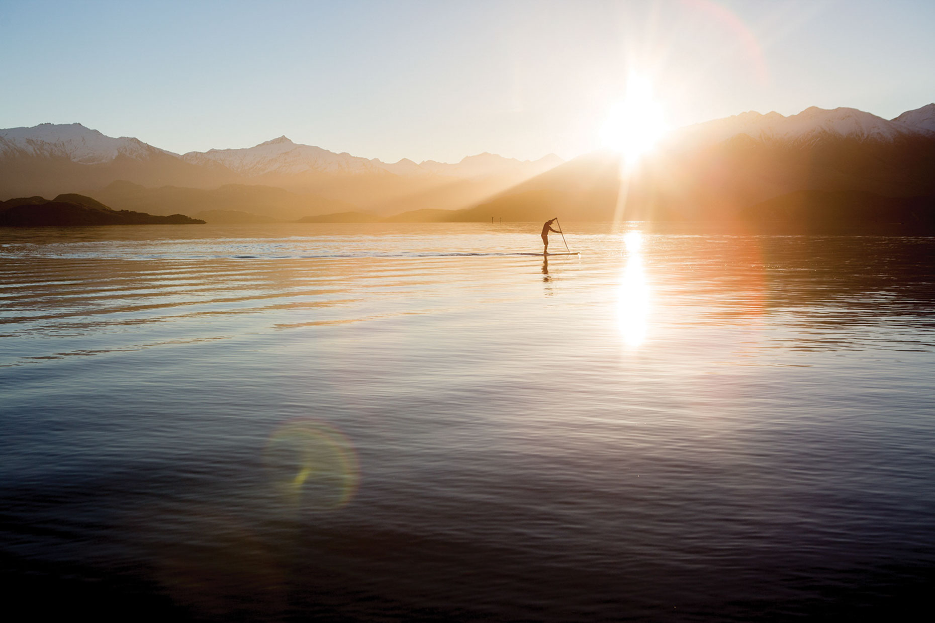 Stand up paddle boarding at sunset, Lake Wanaka.